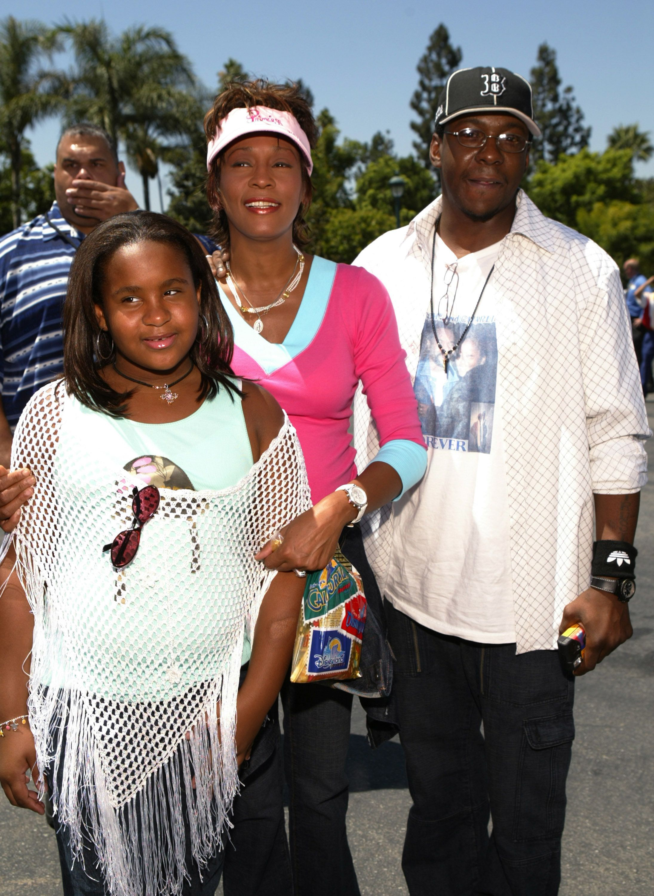 Whitney Houston, Bobby Brown and their daughter Bobbi Kristina (left) (Photo by Lee Celano/WireImage)
