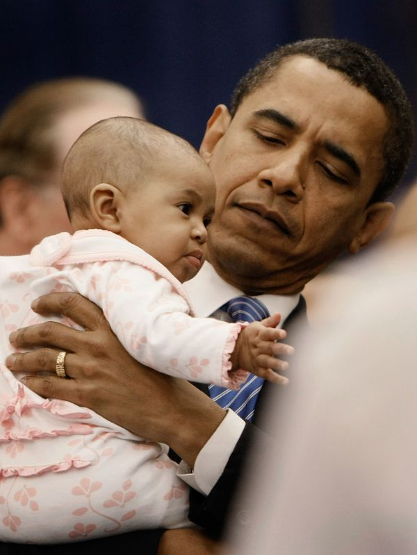 President Obama offers us an important fashion lesson:When your suit is a little on the plain side, add a babyto