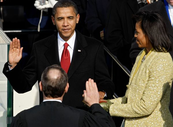 President Obama's red tie combined with Michelle Obama's chartreuse jacket is like Christmas in July.