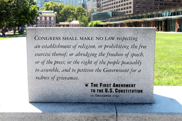 A marble plaque reading of The First Amendment To The U.S. Constitution sits on Independence Mall in Philadelphia, Pennsylvan