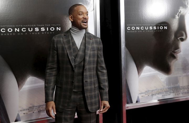 "Actor Will Smith poses as he arrives for the New York premiere of the film ""Concussion"" in the Manhattan borough of New York"