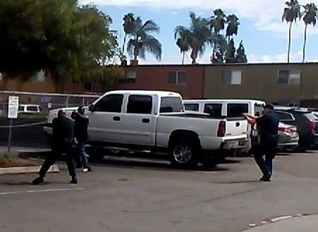 A screengrab of a deadly confrontation between a black man and El Cajon police officers.