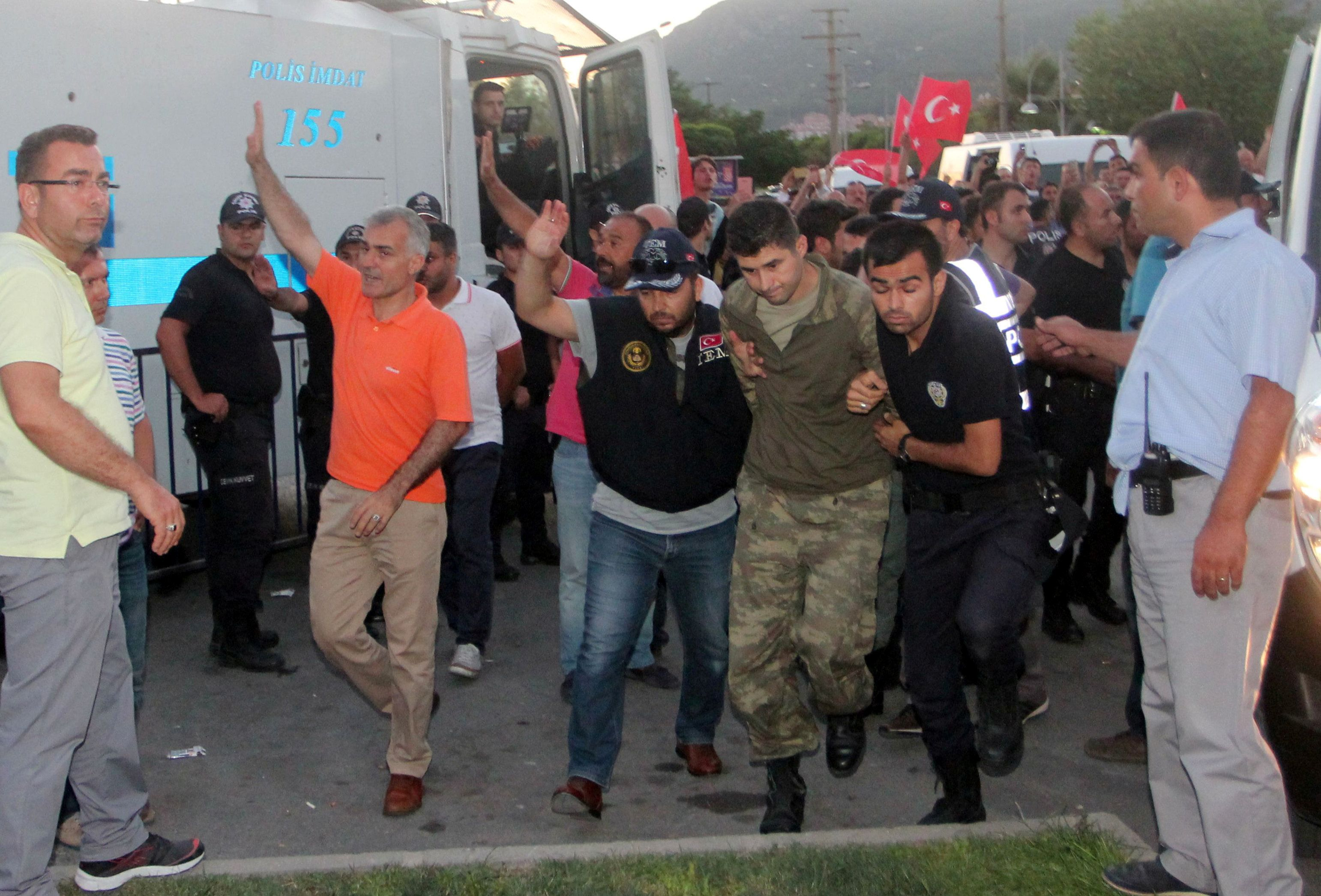 Soldiers suspected of being involved in the coup attempt are escorted by policemen as they arrive at a courthouse in the resort town of Marmaris, Turkey, July 17, 2016. REUTERS/Kenan Gurbuz