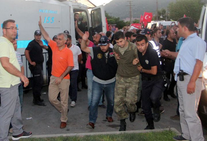 Soldiers suspected of being involved in the coup attempt are escorted by policemen to a courthouse in Marmaris, Turkey,