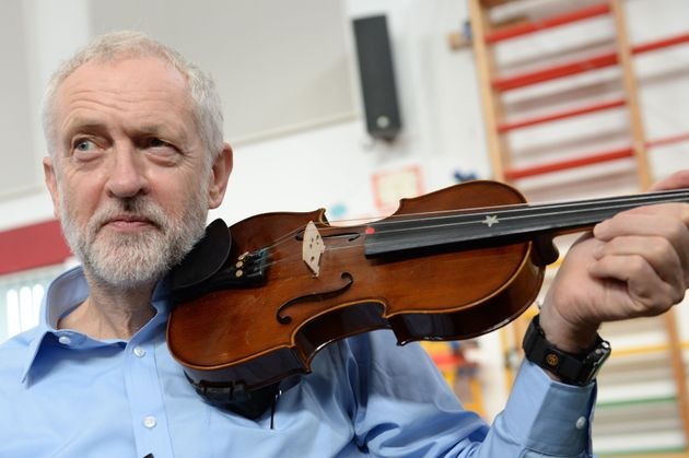 Corbyn plays the violin on a visit to a school in