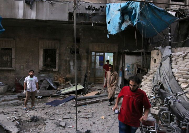 Medics inspect the damage outside a field hospital after an airstrike in the rebel-held al-Maadi neighbourhood of Aleppo, Syr