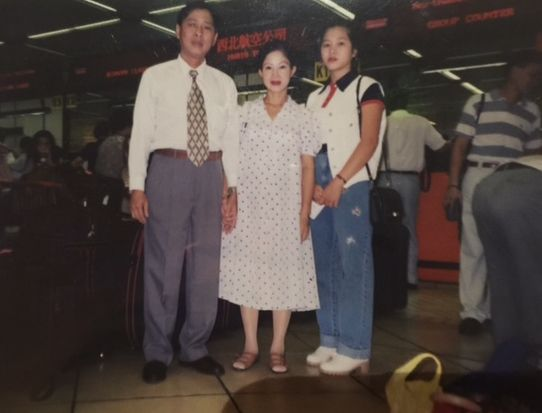 The family before they departed Hong Kong for the U.S. in 1995