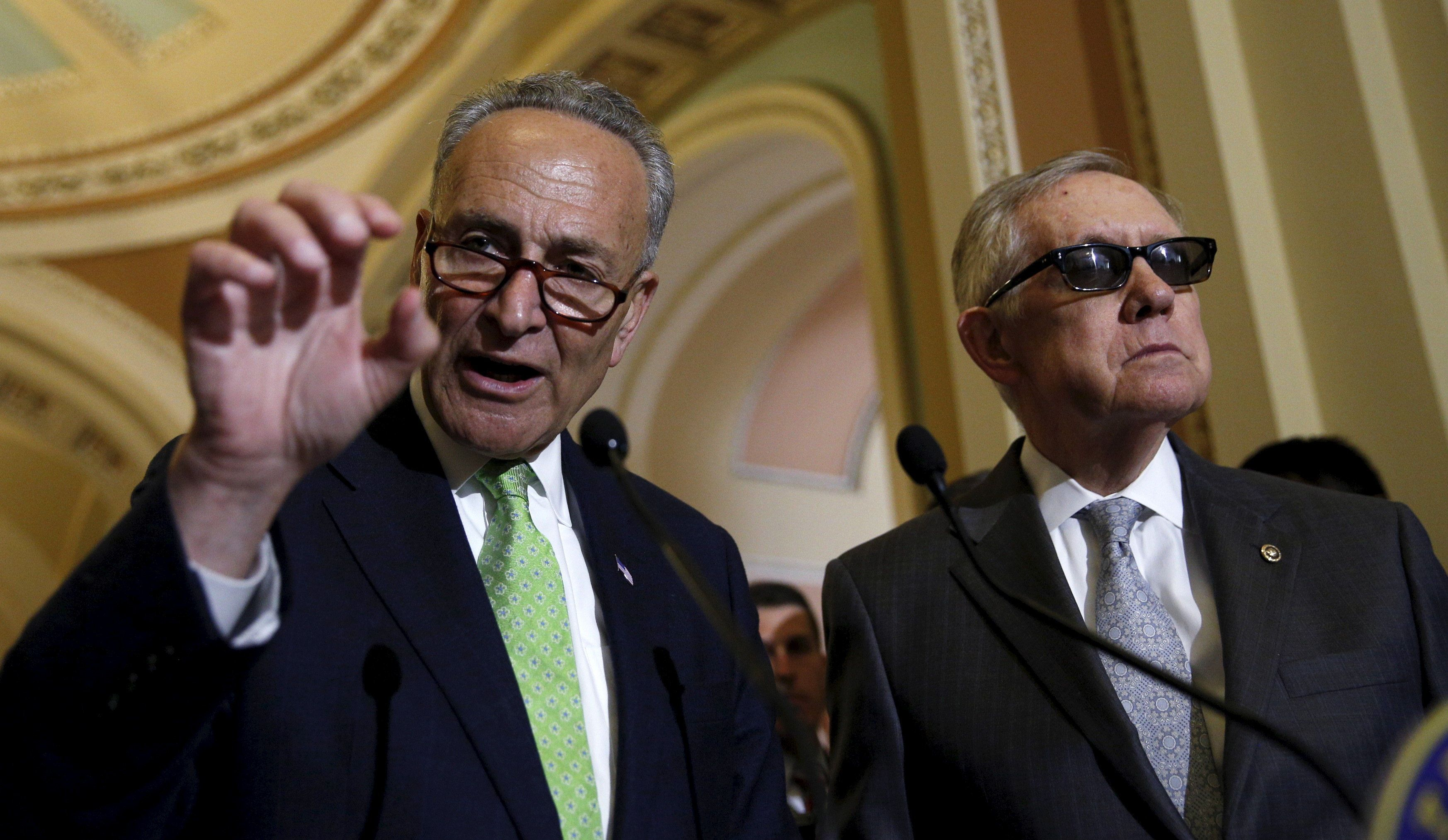 Senator Chuck Schumer  (D-NY) speaks to reporters as Senate Minority Leader Harry Reid stands beside him following the party's weekly policy lunch at the U.S. Capitol in Washington May 5, 2015. REUTERS/Kevin Lamarque