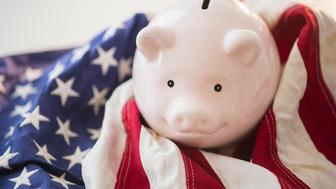 Close up of piggy bank and American flag