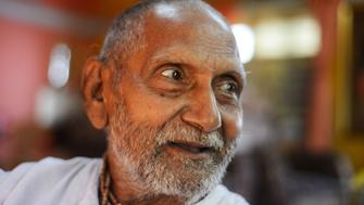 In this photograph taken on August 2, 2016, Indian monk Swami Sivananda who claims to be 120 years old, smiles ahead of performing his morning stretches and yoga in Kolkata.  An Indian monk who claims to be the oldest man to have ever lived at 120 years, says he owes his longevity to daily yoga and a life without sex or spices. Born on August 8, 1896, according to his passport, Hindu monk Swami Sivananda's life has spanned three centuries. He is now applying to Guinness World Records to stake his claim to the distinction.   / AFP / Dibyangshu SARKAR / TO GO WITH AFP STORY:  India-Lifestyle-Oldest-Man, FEATURE by Dibyangshu SARKAR        (Photo credit should read DIBYANGSHU SARKAR/AFP/Getty Images)