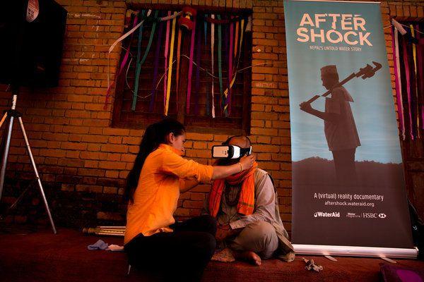 Volunteer, Ganga Sunuwar (left), helping one of the elderly community members to watch the VR