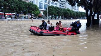 People take a boat at a flooded area as Typhoon Megi lands in Fuzhou, Fujian province, China, September 28, 2016. REUTERS/Stringer ATTENTION EDITORS - THIS IMAGE WAS PROVIDED BY A THIRD PARTY. EDITORIAL USE ONLY. CHINA OUT. NO COMMERCIAL OR EDITORIAL SALES IN CHINA.