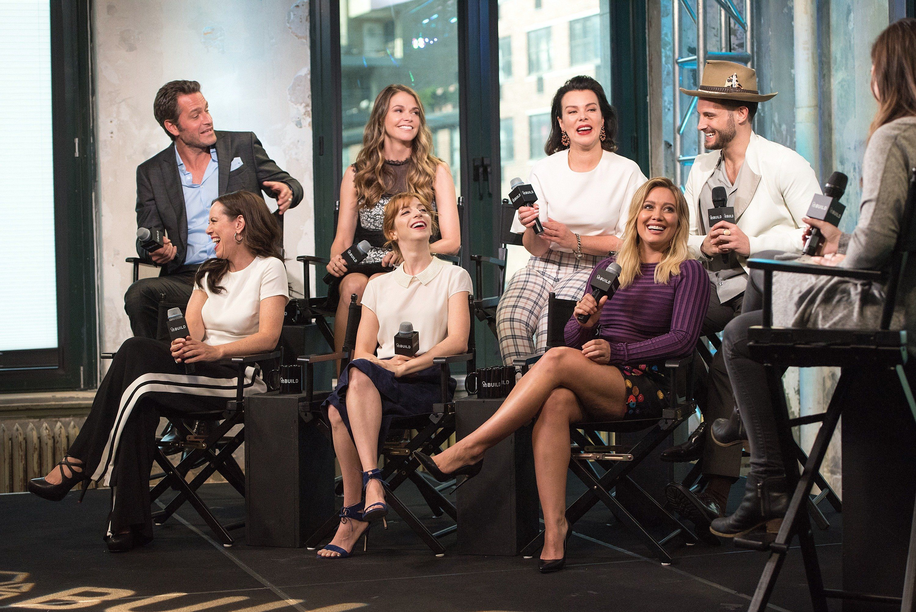 NEW YORK, NY - SEPTEMBER 26:  (Back L-R) Peter Hermann, Sutton Foster, Debi Mazar, Nico Tortorella, (Front L-R) Miriam Shor, Molly Bernard, and Hilary Duff attend the Build Series to discuss 'Younger' at AOL HQ on September 26, 2016 in New York City.  (Photo by Mike Pont/WireImage)