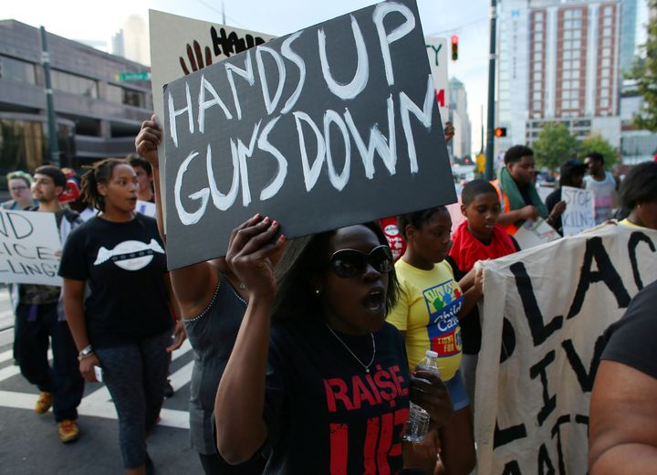 Demonstrators march to protest the police shooting of Keith Scott in Charlotte, North Carolina.