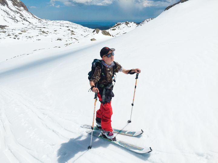 The author's son, Luke, ascends a slope while backcountry skiing with his father near Nederland, Colorado.