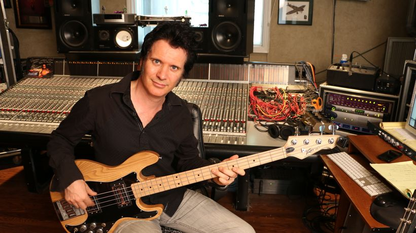 Warren in his studio on bass guitar, one of seemingly dozens of instruments on which he is a master!