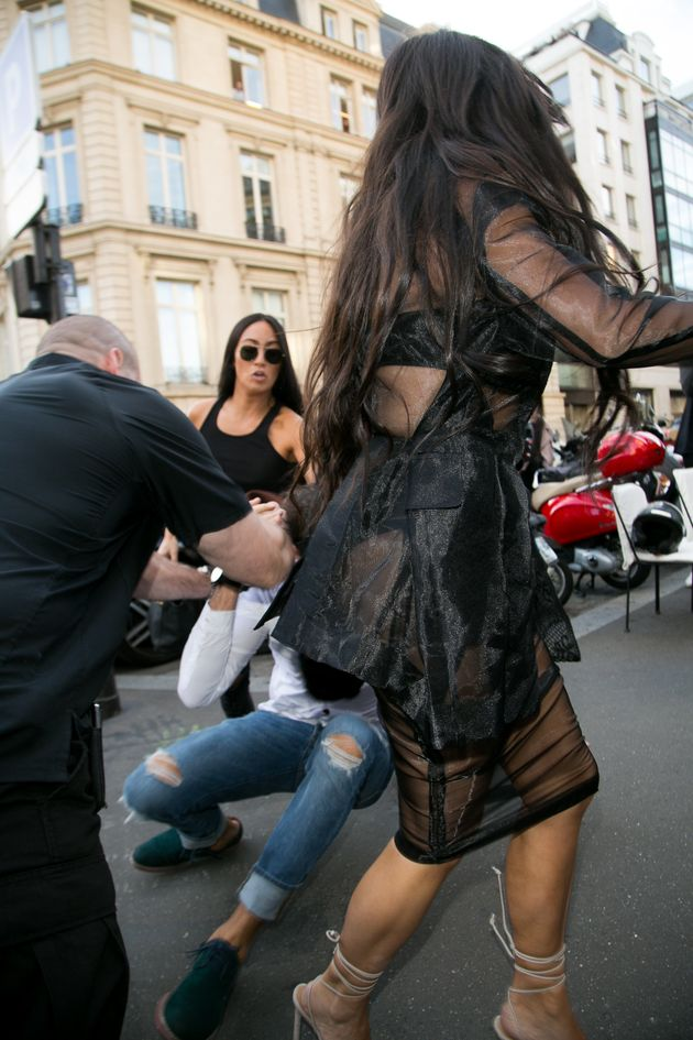 Vitalii Sediuk jumps at Kim Kardashian West's behind as she arrives at L'Avenue restaurant in