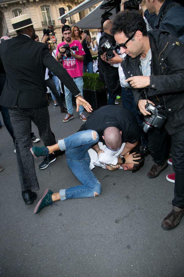 Bodyguard Pascal Duvier immobilizes Vitalii Sediuk after jumping on Kim Kardashian West in Paris.