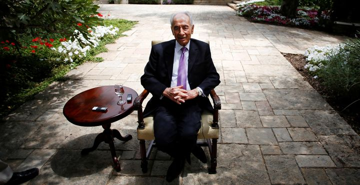 Israel's late president, Shimon Peres, speaks during an interview with Reuters at his residence in Jerusalem on June 16,
