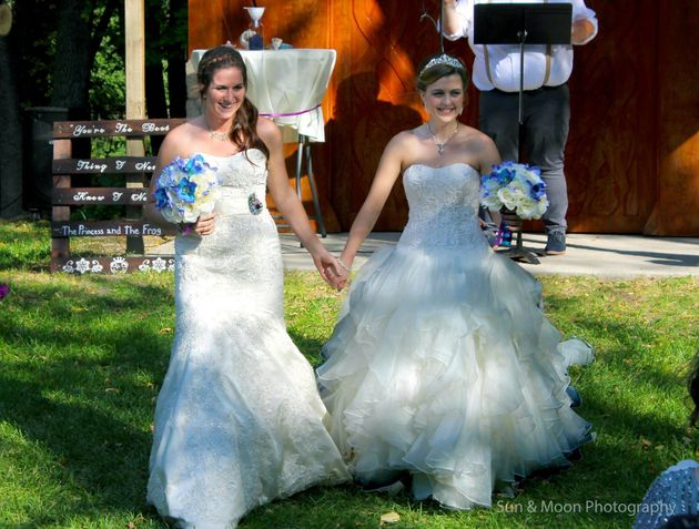 The beaming brides on their wedding