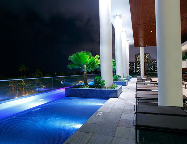 The pool at Trump International Hotel Waikiki offers great shade during the day and a gorgeous view at night.