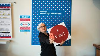MINNEAPOLIS, MN - SEPTEMBER 23: Minneapolis resident Robin Marty takes a selfie with an 'I Voted' sign after voting early at the Northeast Early Voting Center on September 23, 2016 in Minneapolis, Minnesota. Minnesota residents can vote in the general election every day until Election Day on November 8. (Photo by Stephen Maturen/Getty Images)