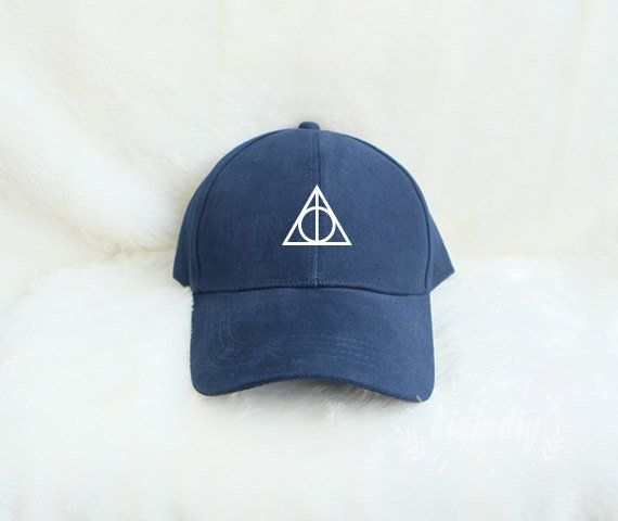 "Deathly Hallows baseball cap, $14.99 at <a href=""https://www.etsy.com/listing/398154055/deathly-hallows-baseball-hat-harry?ga"