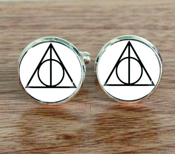 "Cufflinks, $8.99 at <a href=""https://www.etsy.com/listing/220314780/harry-potter-always-triangle"" target=""_blank"">Etsy</a>"