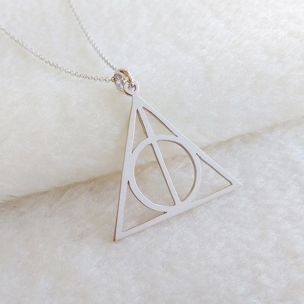 "Deathly Hallows necklace, $27.95 at <a href=""https://www.etsy.com/listing/475368393/harry-potter-symbol-necklaceharry-potter"""