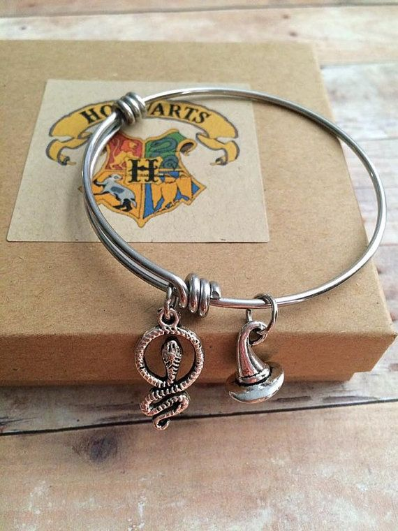 "Slytherin Sorting Hat bracelet, $17 at <a href=""https://www.etsy.com/listing/348956357/harry-potter-sorting-hat-slytherin-cha"