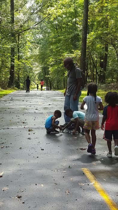 Walli Williams with students on a trail
