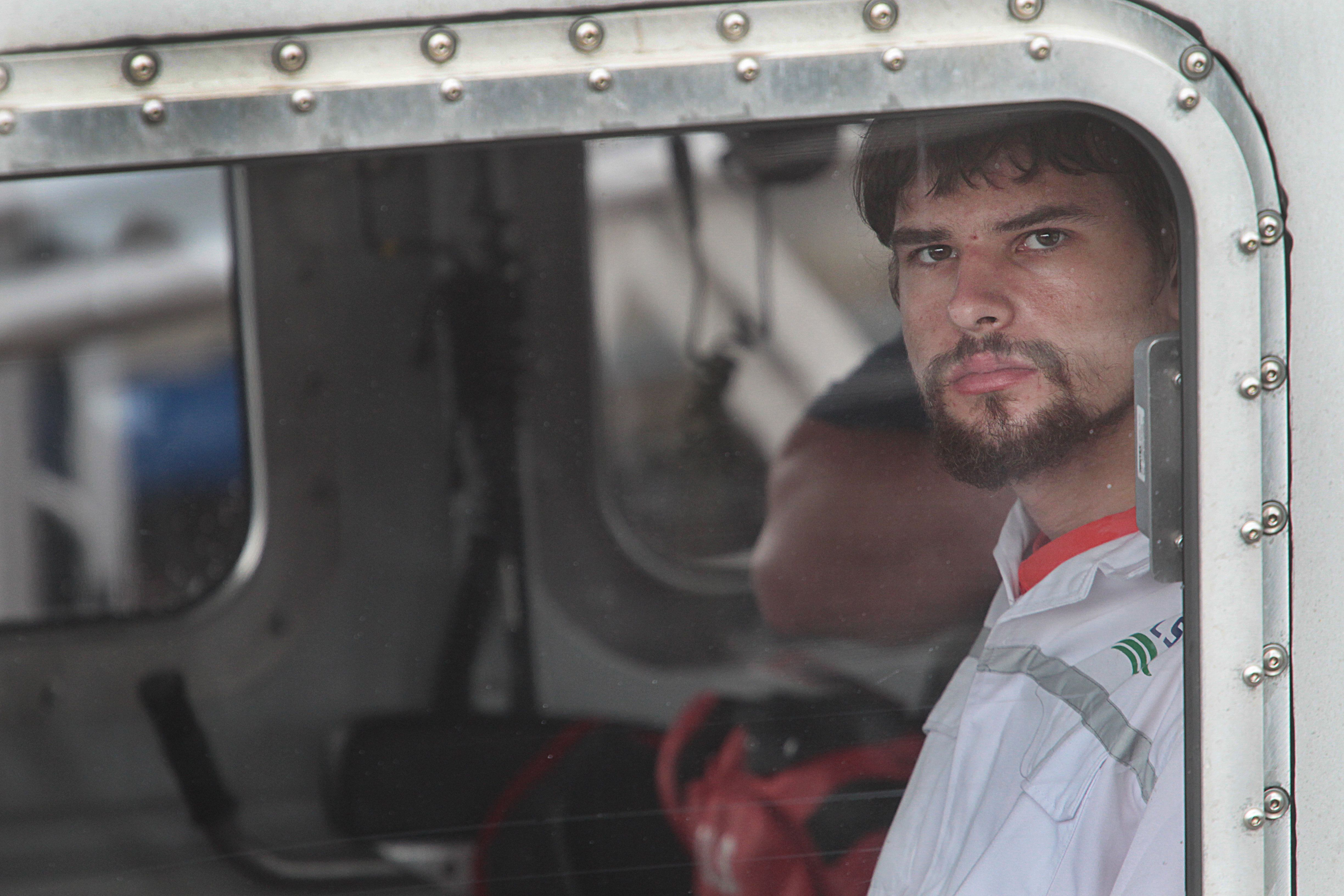 Nathan Carman, 22, is seen arriving in Boston on Tuesday after being rescued from a lifeboat off Martha's Vineyard on Sunday.