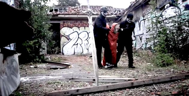 A still from the video 'Off With Their