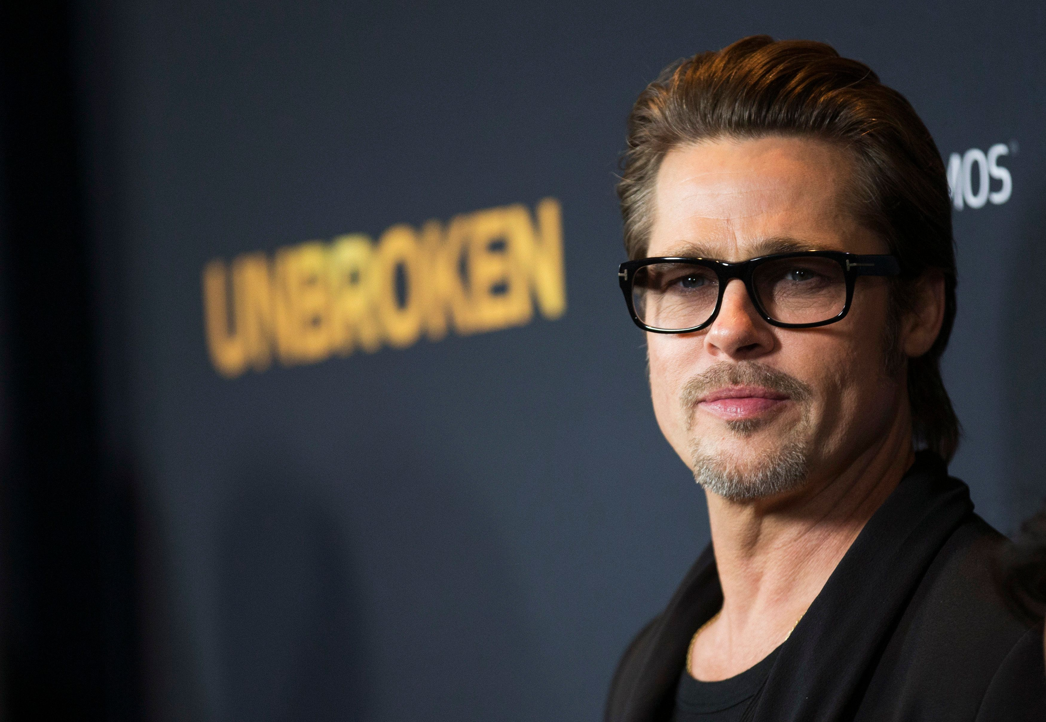 """Actor Brad Pitt poses at the premiere of """"Unbroken"""" at Dolby theatre in Hollywood, California Dec.15, 2014."""