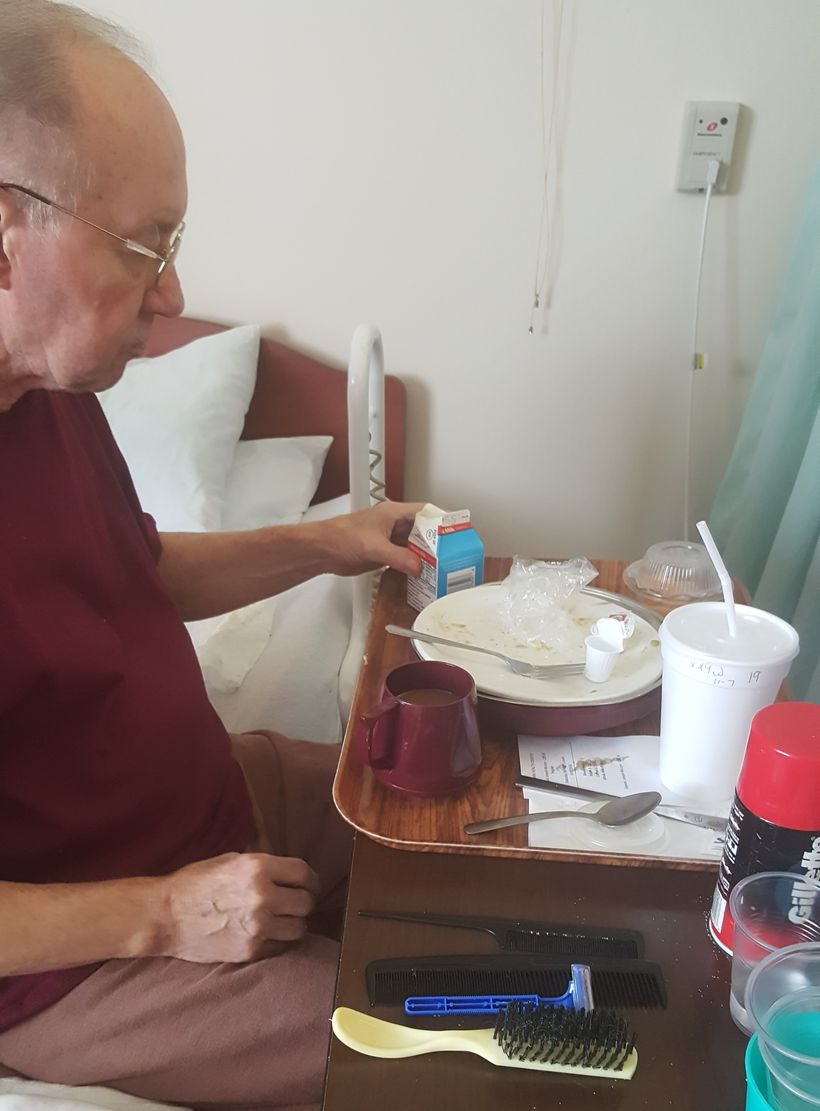 Dad eating lunch. Note the handy grooming tools.