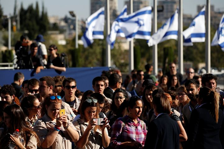 Israelis look on as the flag-draped coffin of former Israeli President Shimon Peres, is displayed at the Knesset plaza, the I