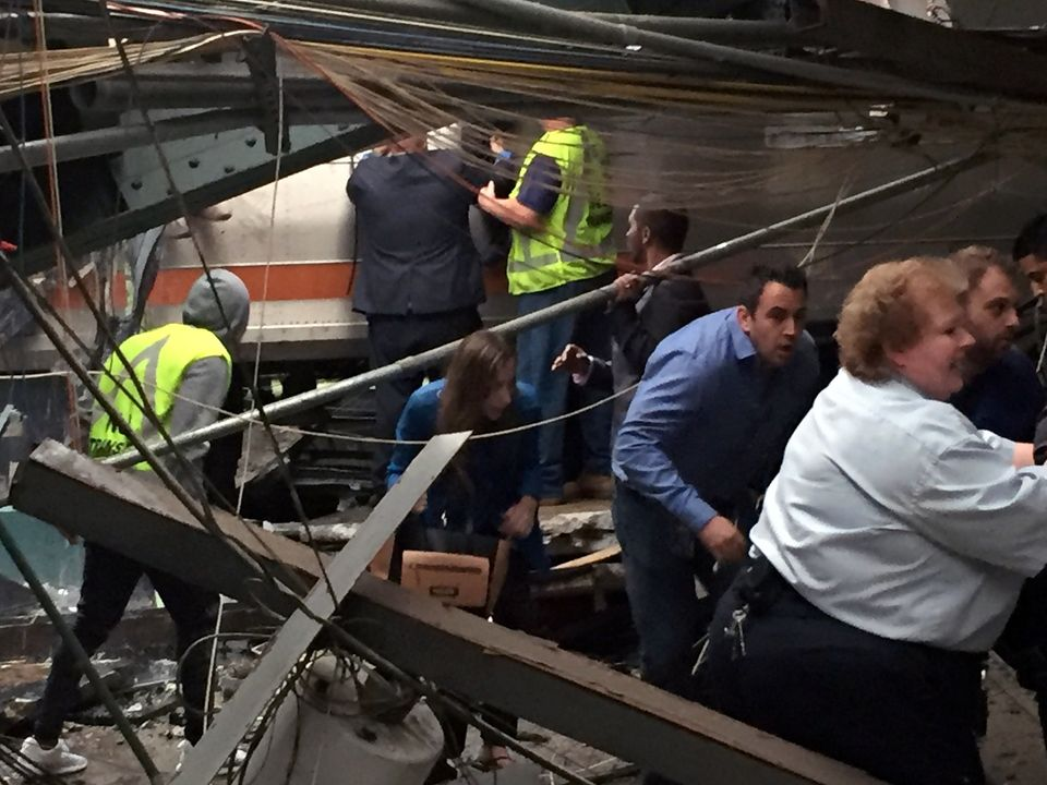 Passengers rush to safety after a NJ Transit train crashed in to the platform at the Hoboken Terminal September 29, 2016 in H