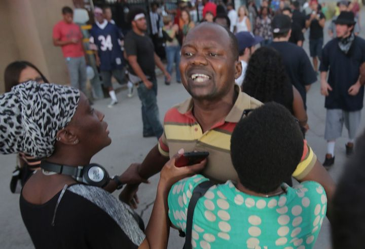 A man claiming to be Alfred Olango's cousin shouts at police during a rally in El Cajon.