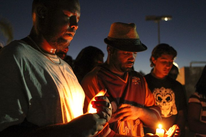 Mourners and activists hold a candle light vigil during a rally in El Cajon, a suburb of San Diego.