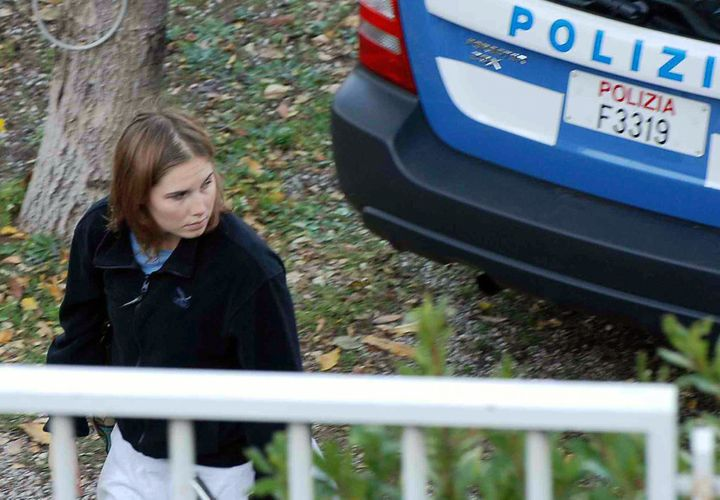Knox stands outside her Perugia home just days after Kercher's murder.