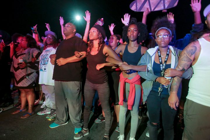 Protesters lock arms in front of a police line in El Cajon, a suburb of San Diego, California.