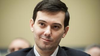 Martin Shkreli, former chief executive officer of Turing Pharmaceuticals LLC, smiles during a House Committee on Oversight and Government Reform hearing on prescription drug prices in Washington, D.C., U.S., on Thursday, Feb. 4, 2016. Shkreli, who is no longer with Turing and faces federal fraud charges unrelated to the drugmaker, declined to make any comments to the committee. 'On the advice of counsel, I invoke my Fifth Amendment,' Shkreli said. Photographer: Pete Marovich/Bloomberg via Getty Images