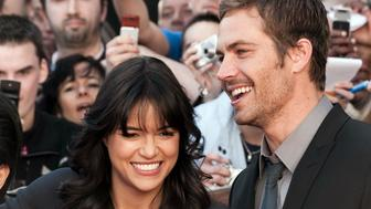 Michelle Rodriguez and Paul Walker at the photo call of 'Fast & Furious 4' in Lille. (Photo by Stephane Cardinale/Corbis via Getty Images)