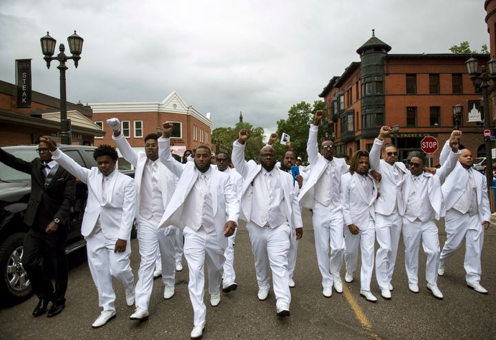 Pallbearers lead a march down Selby Avenue after the funeral of Philando Castile.