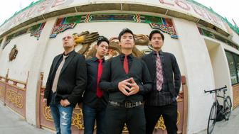 Portrait of Asian-American band The Slants (L-R: Joe X Jiang, Ken Shima, Tyler Chen, Simon 'Young' Tam, Joe X Jiang) in Old Town Chinatown, Portland, Oregon, USA on 21st August 2015. (Photo by: Anthony Pidgeon/Redferns)