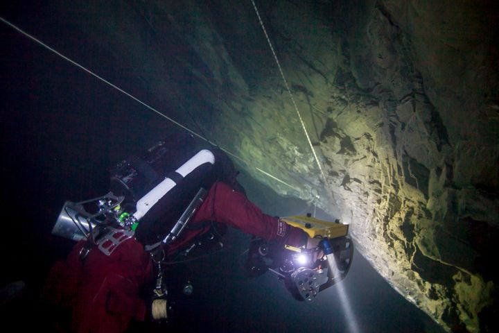 The remotely operated vehicle descending toward the bottom of the cave.