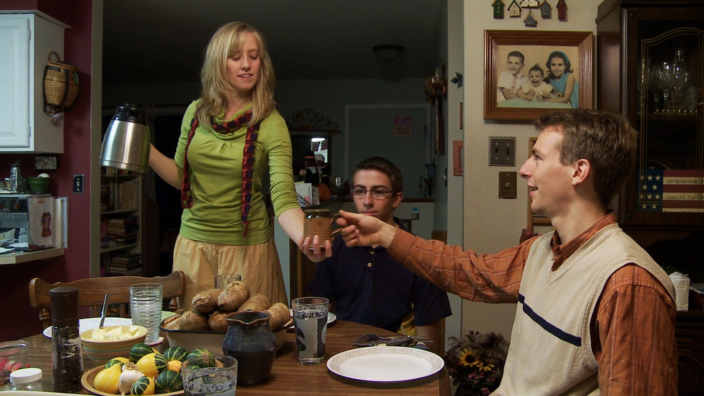 Kelly Boggus serves waterto Ross and his younger brother at a family dinner orchestrated to see if the young people mig