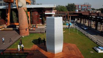 The Smog Free Tower, the world's largest smog vacuum cleaner designed by Dutch artist and innovator Daan Roosegaarde is seen at former industrial zone, now D-751 art district, as the artist presents his The Smog Free Project in Beijing September 29, 2016. The Smog Free Project consist of 7-meter tall the Smog Free Tower, the large air purifier that creates an area of clean air around it and the Smog Free Jewellery that are made of compressed smog particles.   REUTERS/Damir Sagolj