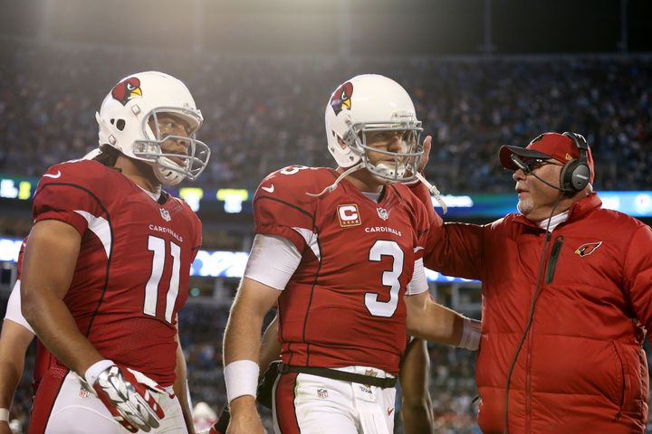 It's far too early to panic on Larry Fitzgerald (left), Carson Palmer and head coach Bruce Arians.