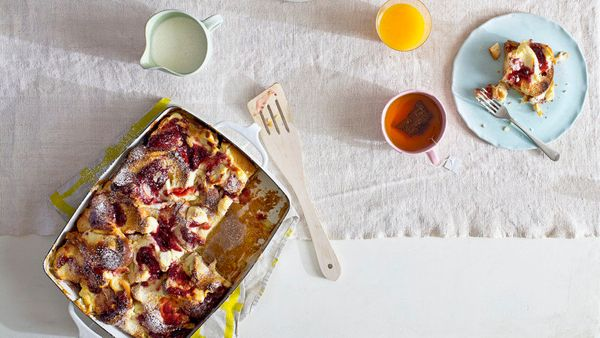 A hot, bubbling breakfast strata practically oozes comfort. This one combines tart raspberries and tangy goat cheese with ple